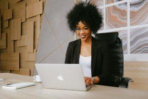 Women-Smiling-at-Computer